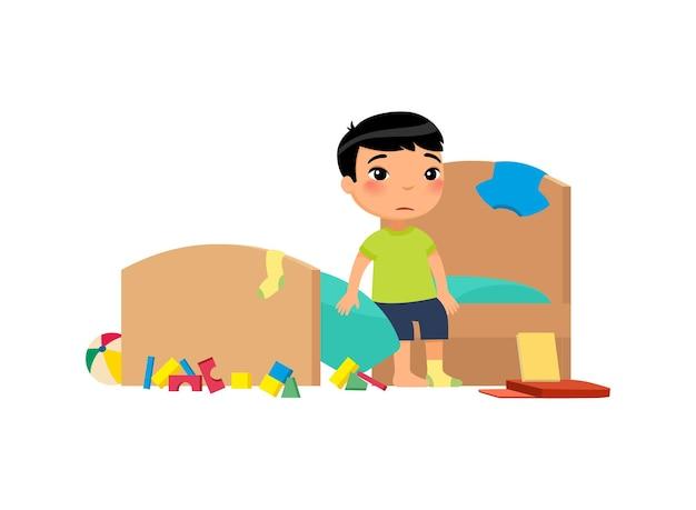 Niño molesto en la limpieza de las tareas del dormitorio desordenado