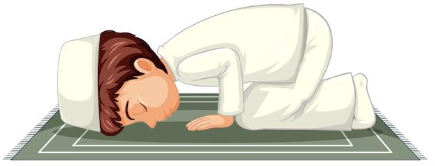 Niño musulmán árabe orando en vestimentas tradicionales aislado sobre fondo blanco.