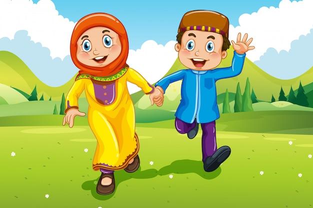 Niño musulmán y niña tomados de la mano