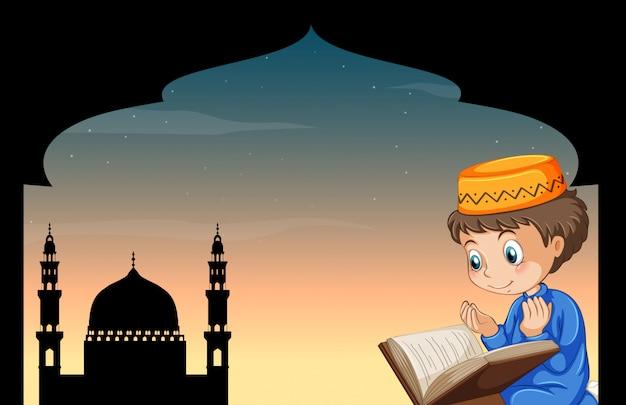 Niño musulmán rezando con mezquita