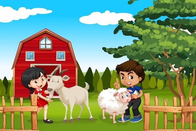 Niño y niña con animales de granja en la granja