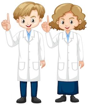 Niño y niña en bata de ciencia apuntando el dedo hacia arriba