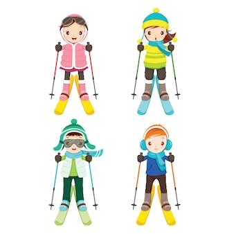 Niño y niña en conjunto de ropa de esquí
