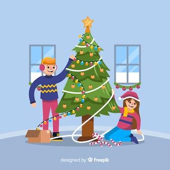 Niño y niña decorando el árbol de navidad