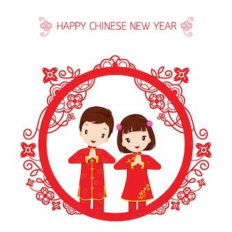 Niño y niña dentro del marco del círculo, celebración tradicional, china, feliz año nuevo chino