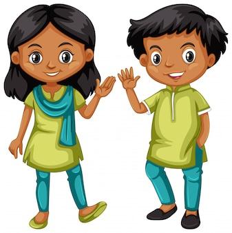 Niño y niña de la india en traje verde y azul.