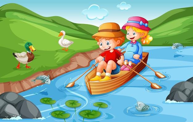 Niño y niña reman el bote en el parque natural
