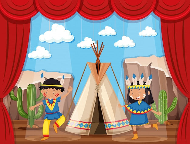 Niño y niña tocando indios nativos en el escenario