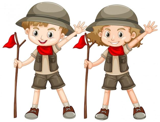 Niño y niña en traje de safari con bandera roja