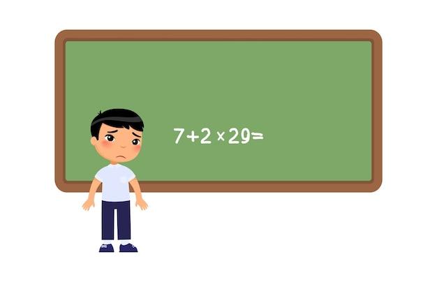 Niño no puede resolver el difícil ejemplo en la junta escolar