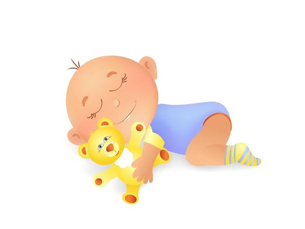 Niño pequeño en azul mono y calcetines para bebé duerme y abraza con oso de juguete amarillo