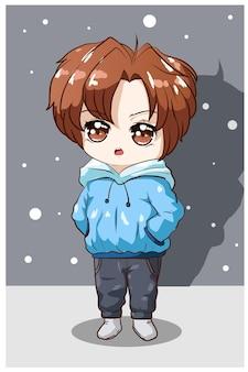 Niño pequeño cabello castaño con ilustración de sudadera con capucha azul
