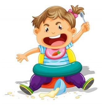 Niño pequeño comiendo y haciendo un desastre