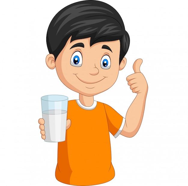 Niño pequeño de dibujos animados con un vaso de leche dando pulgar