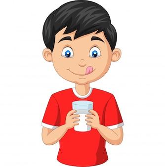 Niño pequeño de dibujos animados con un vaso de leche