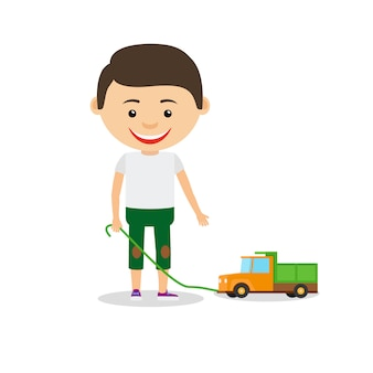 Niño pequeño muestra su coche de juguete