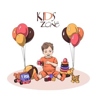 Niño pequeño sentado y jugando con juguetes
