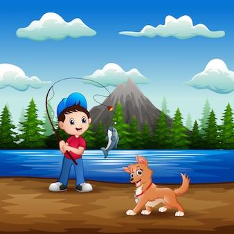 Un niño pescando con su mascota en el río.