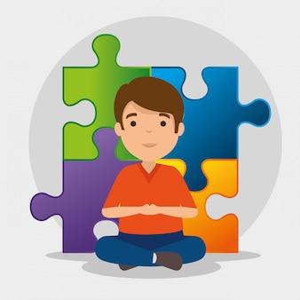Niño con rompecabezas para el día de la conciencia del autismo