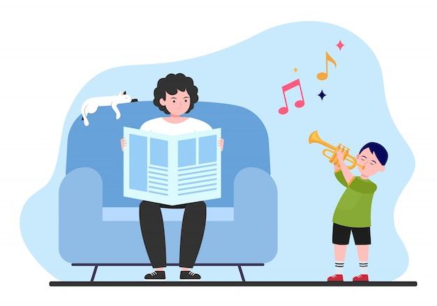 Niño tocando la trompeta en casa