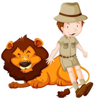 Niño en traje de safari y león salvaje.