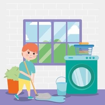 Niño trapear y productos de limpieza delante de la ventana