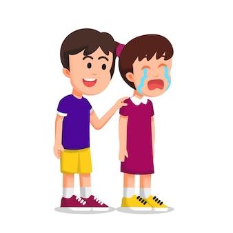 Niño tratando de calmar a una niña llorando