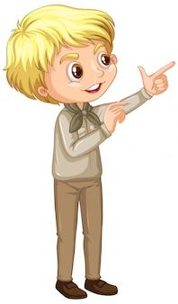 Niño en uniforme de scout apuntando en blanco