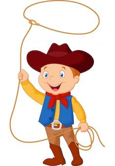 Niño vaquero girando un lazo