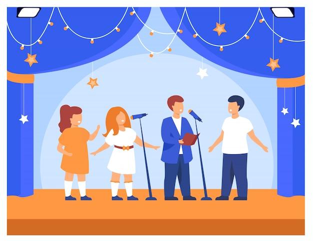Niños actuando en fiesta escolar o concierto.
