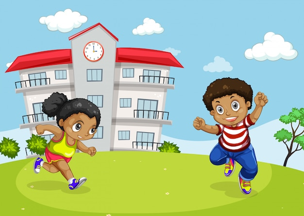 Niños africanos en frente de la escuela