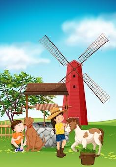 Niños y animales en el corral.