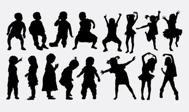 Niños bailando silueta