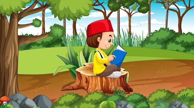 Los niños de brunei visten ropas tradicionales y leen un libro en el bosque
