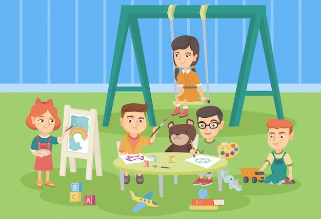 Niños caucásicos jugando en el patio de recreo.