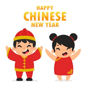 Niños chinos vestidos con trajes nacionales saludando para el festival del año nuevo chino.