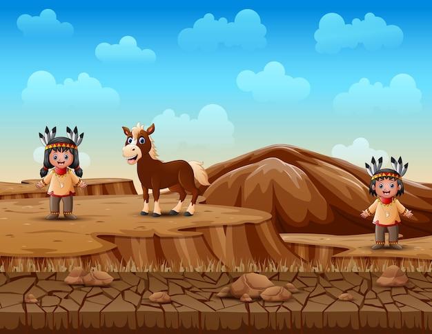 Niños de dibujos animados nativo americano indio en paisaje de tierra seca