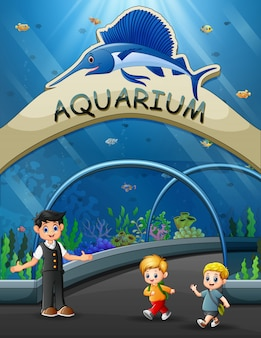 Niños de dibujos animados a pie al museo submarino