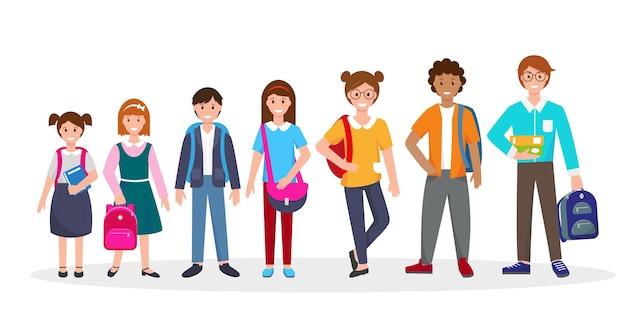 Niños de la escuela con libros y mochilas escolares en blanco