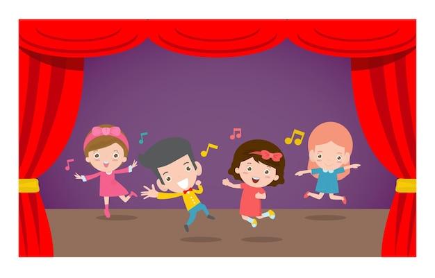 Niños felices bailando y saltando en el escenario.