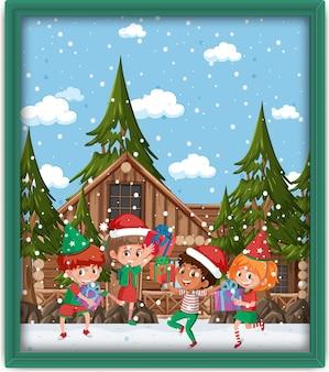 Niños felices en la foto del tema de navidad en un marco