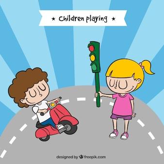 Niños felices jugando con una motocicleta y un semáforo