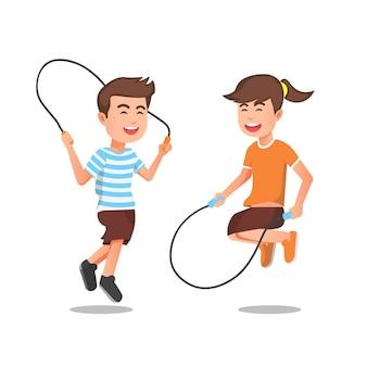 Niños felices jugando a saltar la cuerda