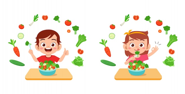 Los niños felices lindos comen frutas vegetales de ensalada