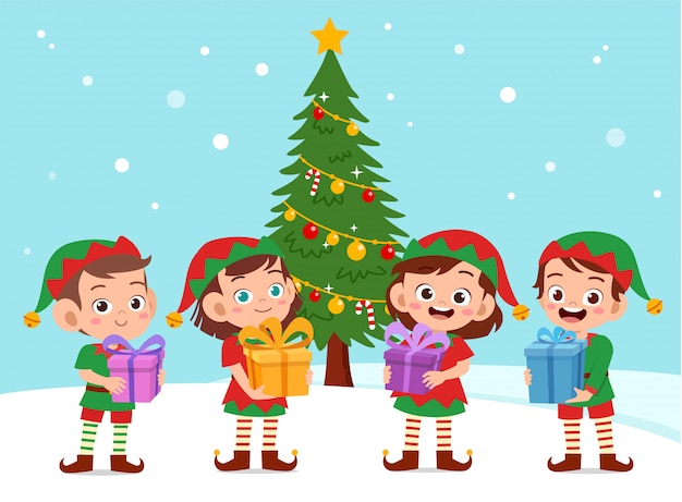 Niños felices llevan regalo navidad