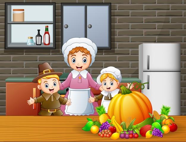 Niños felices y mamá en la cocina.