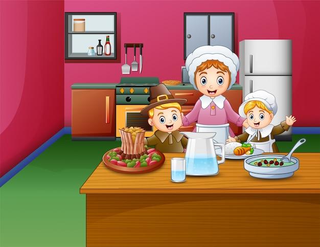 Niños felices y mamá cocinando comida en la cocina.