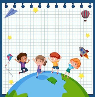 Niños felices en el marco de papel de la tierra