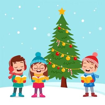 Niños felices navidad cantar musical