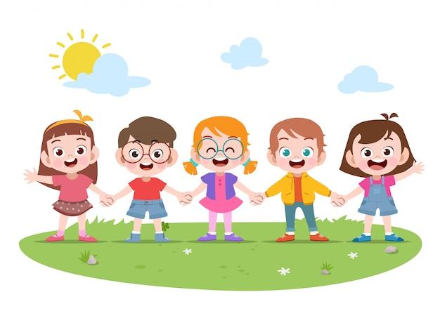 Niños felices niños tomados de la mano